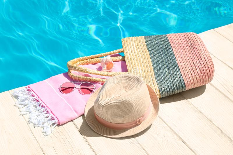Beach accessories on wooden deck. Near swimming pool stock photo