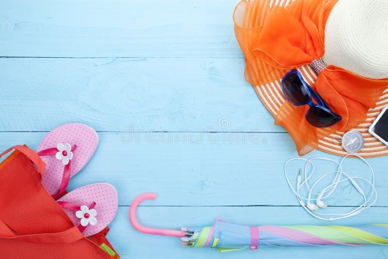 Beach accessory,sunglasses, beach hat,flip-flops,umbrella, compass,music player,earphone on wooden background,concept summer royalty free stock photo