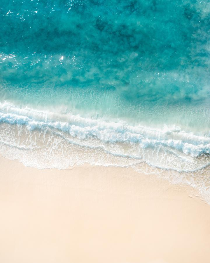 Beach aerial view. Nice top view of the blue ocean, crashing wave and white sand. royalty free stock photo