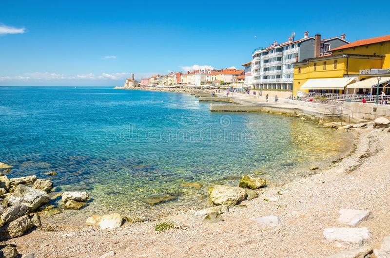 Beach along the waterfront of the historic little town Piran, Slovenia, Europe royalty free stock photography