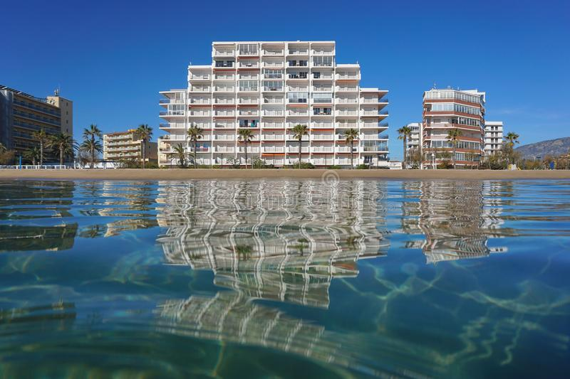 Beach with apartment building Spain Costa Brava stock photo