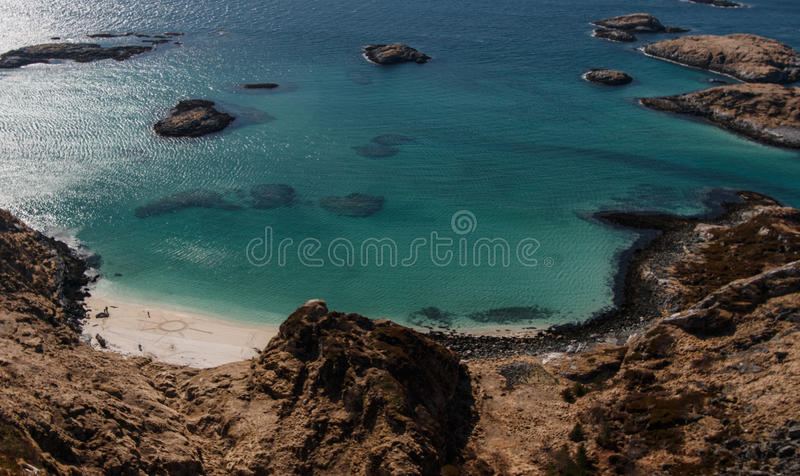 Beach at arctic coast touched by humans royalty free stock photography