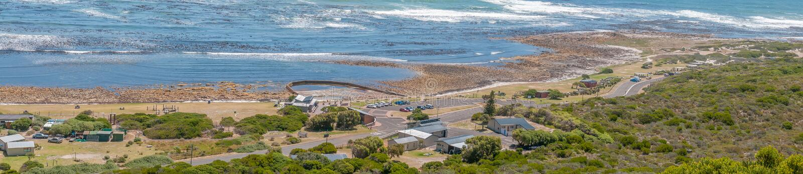 Beach area south of the Slangkop Lighthouse at Kommetjie. CAPE TOWN, SOUTH AFRICA - DECEMBER 12, 2014: Panorama of the beach area south of the Slangkop royalty free stock images