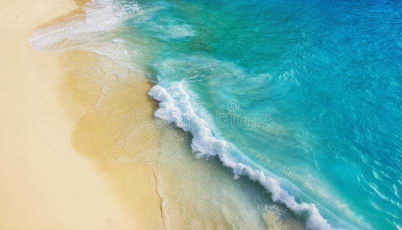 Beach as a background from top view. Waves and azure water as a background. Summer seascape from air. Bali island, Indonesia. Travel - image stock photography