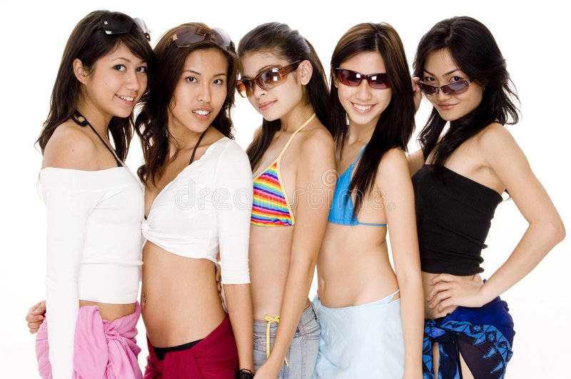 Beach Babes #1. Five pretty young women in summer attire royalty free stock image