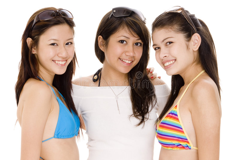 Beach Babes #12. Three cute asian women in summer clothes royalty free stock photos