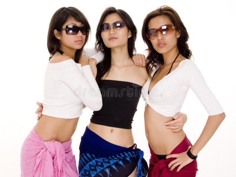 Beach Babes #14. Three cool women in sunglasses stock image