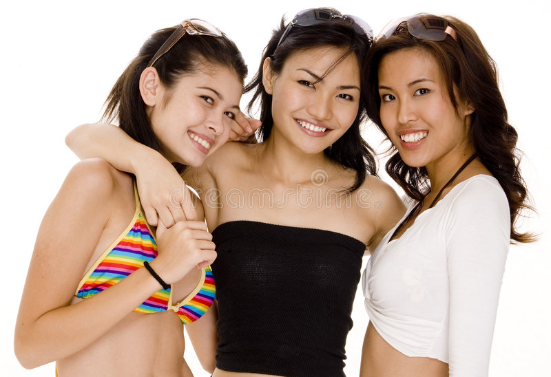 Beach Babes #16. Three pretty asian women in summer wear on white background stock photos