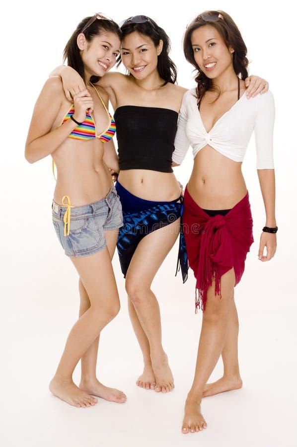 Beach Babes #17. Three young women in beachwear - standing shot stock images