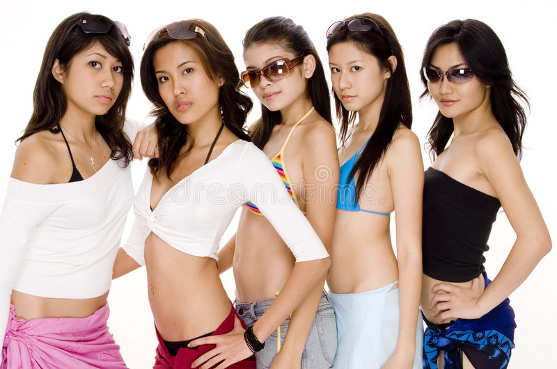 Beach Babes #2. Five pretty but cool young women in bikinis and summer clothes royalty free stock photography