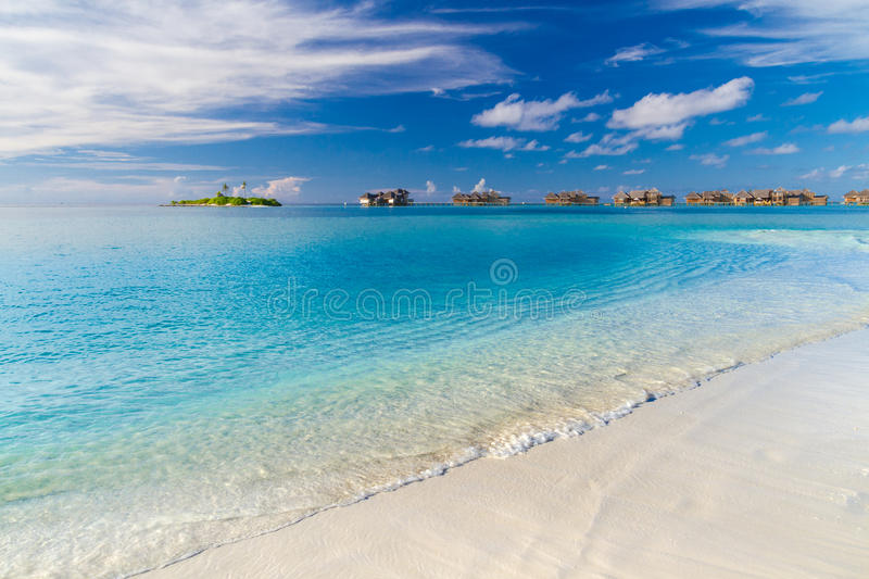 Beach background. Beautiful beach landscape. Tropical nature scene. Palm trees and blue sky. Summer holiday and vacation concept. Vacation holidays background royalty free stock photography
