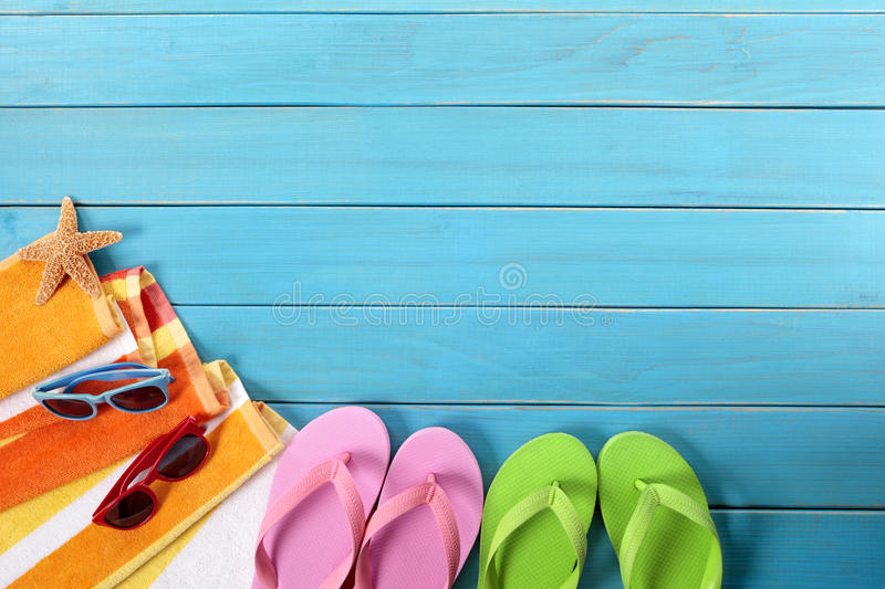 Beach background, flip flops, sunglasses, copy space stock photo