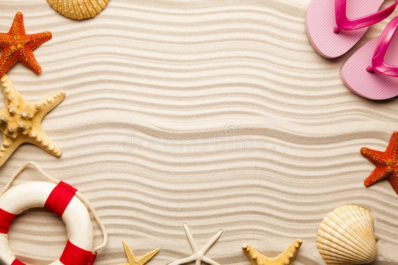 Beach background - shell, starfish, lifebuoy and flip flops royalty free stock images