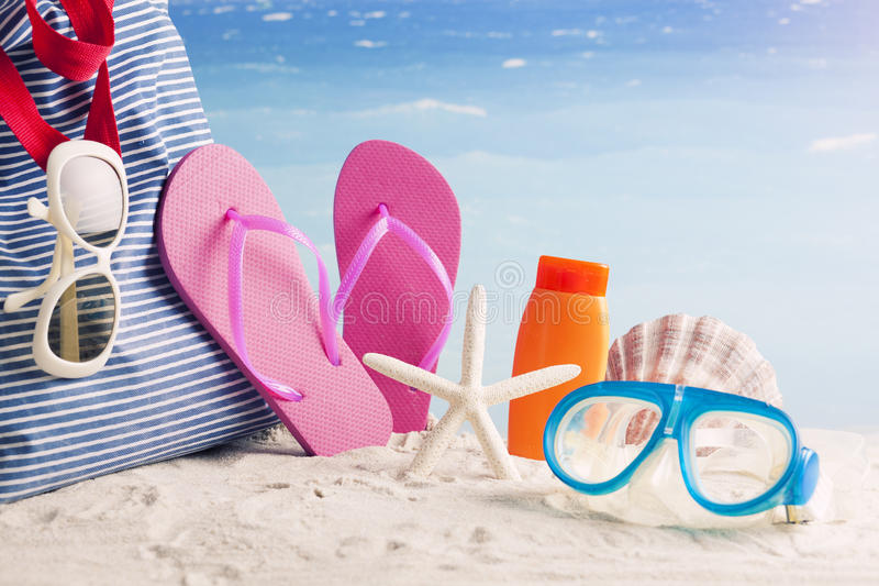 Beach bag with beach accessories royalty free stock photography