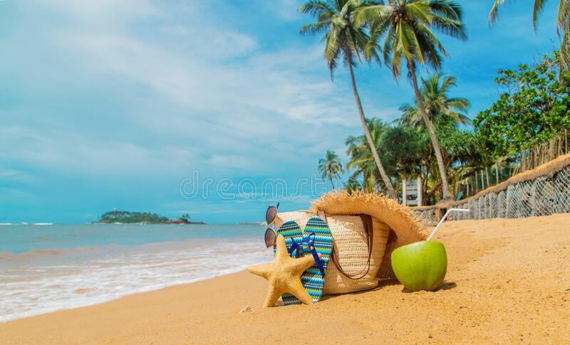 Beach bag and coconut at sea. Selective focus royalty free stock photos