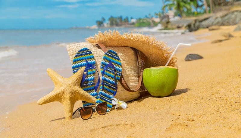 Beach bag and coconut at sea. Selective focus stock images
