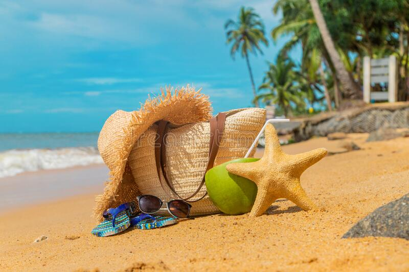 Beach bag and coconut at sea. Selective focus royalty free stock photography