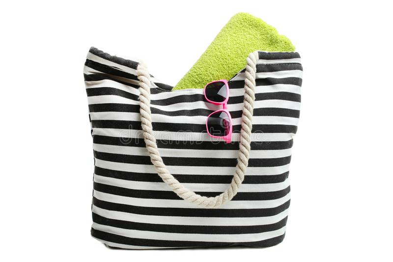Beach bag with green towel and sunglasses stock image