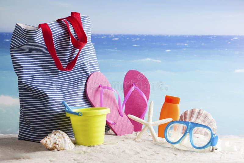 Beach bag, sun glasses and flip flops on a tropical beach. Bag, sun glasses and flip flops on a tropical beach stock photos