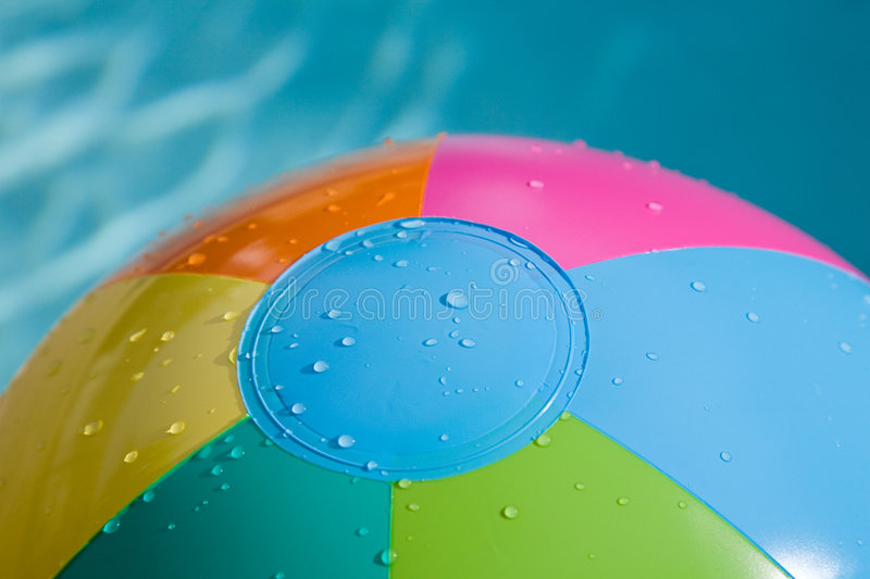 Beach ball with dropplets stock photography