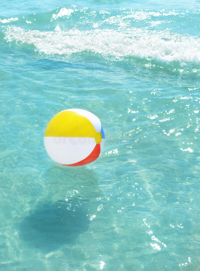 Free Beach Ball Floating In The Ocean. Royalty Free Stock Photo - 58756895