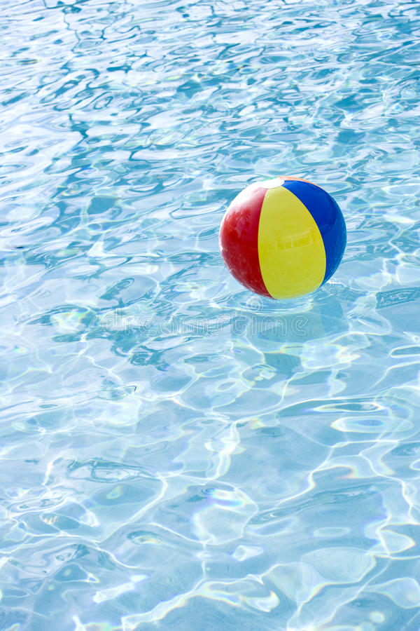 Pool Water With Beach Ball beach ball floating on surface of swimming pool royalty free stock