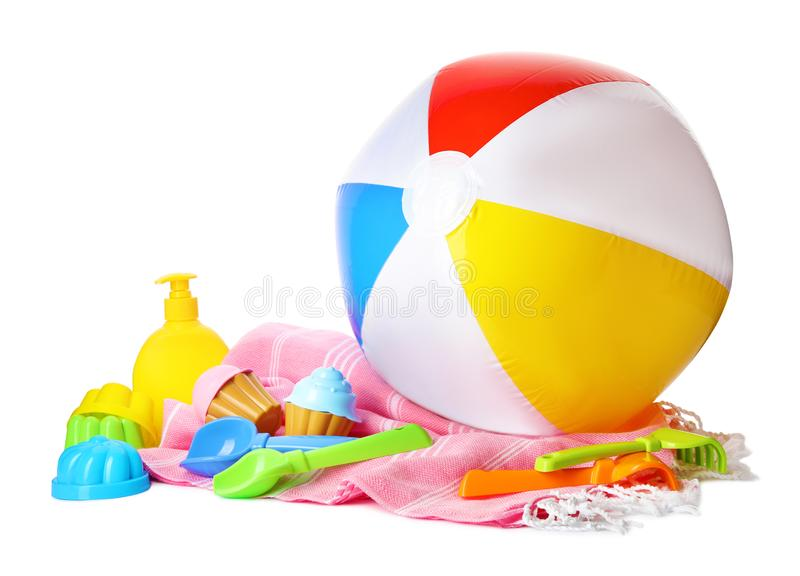Beach ball and plastic toys. On white background royalty free stock photos