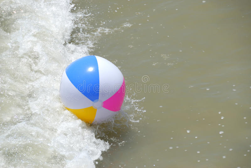Beach Ball In Surf Royalty Free Stock Photo