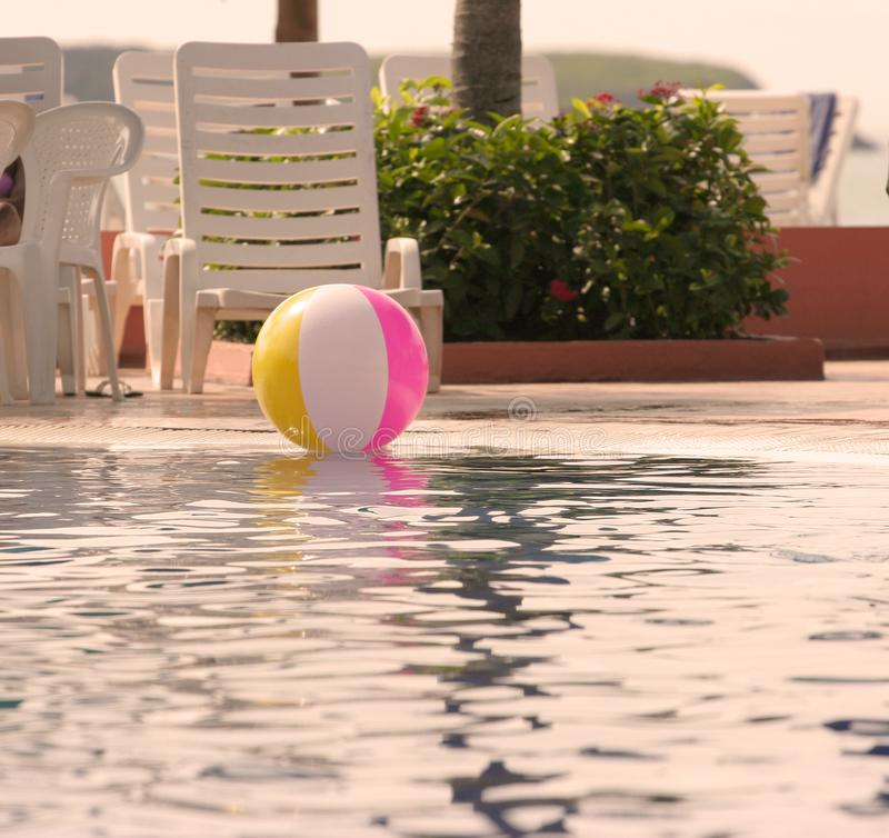 Beach ball in a swimming pool royalty free stock photos