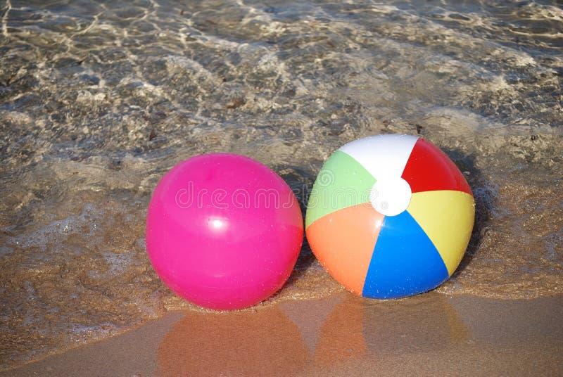 Beach balls. Two bright beach balls in sea stock photo