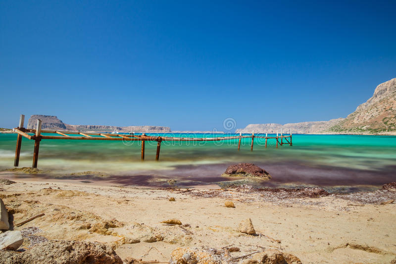 Beach of Balos with sea bridge royalty free stock image