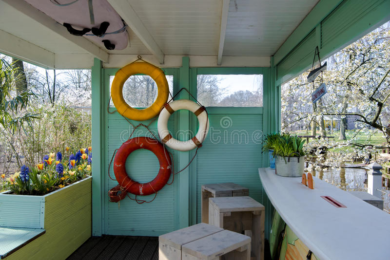 Beach bar with spring flowers stock images