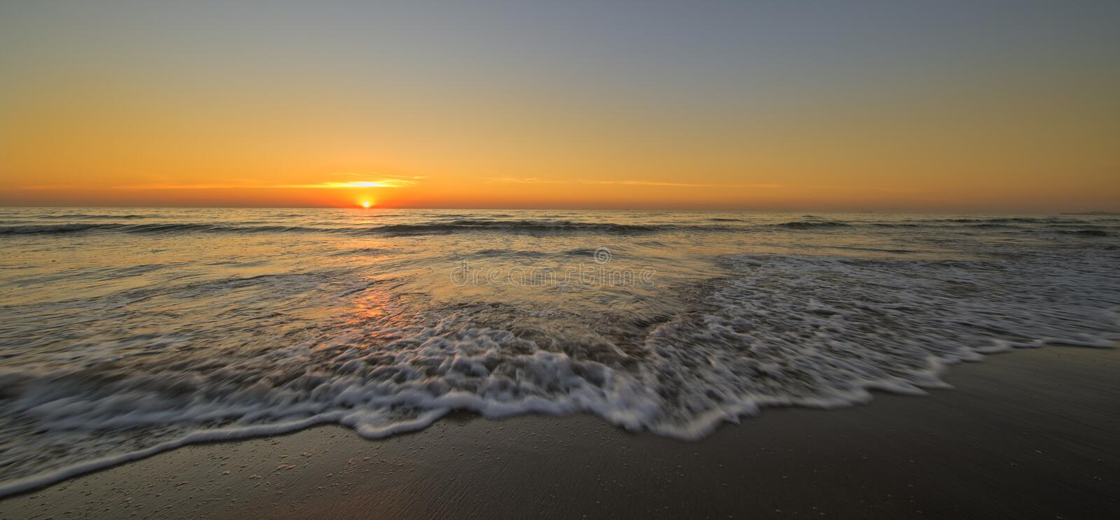The beach of Barcelona at the beautiful sunrise royalty free stock photo