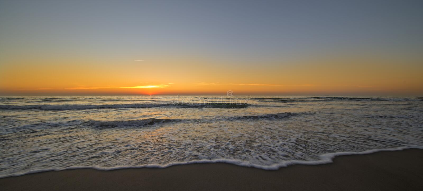 The beach of Barcelona at the beautiful sunrise stock photography