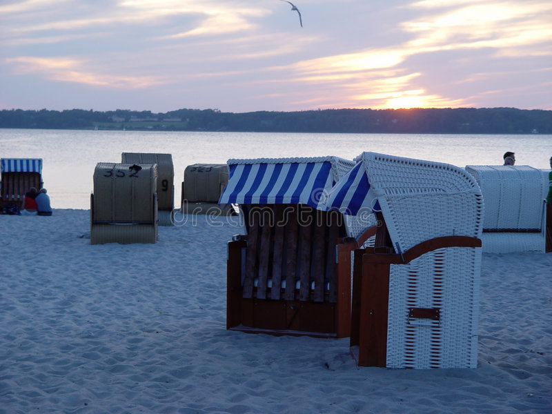 beach baskets in the evening stock photo