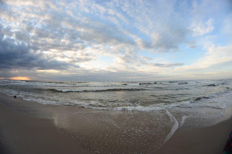 Beach. Beautiful Baltic beach at sunset in the fisheye lens stock photo