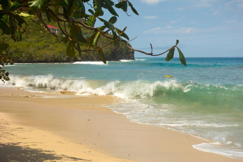 Unseasonal waves crashing against the shore in admiralty bay, bequia stock image