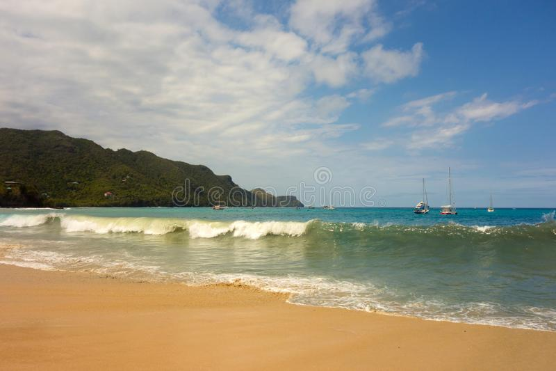 Unseasonal waves crashing against the shore in admiralty bay, bequia stock photos