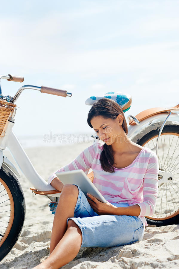 Download Beach bicycle tablet woman stock photo. Image of beautiful - 31057350