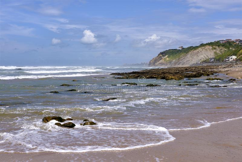 Beach of Bidart in France. Rough sea on the beach of Bidart, a commune in the Pyrénées-Atlantiques department in south-western France stock photography