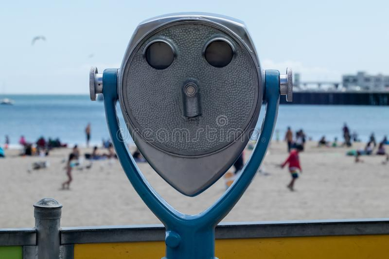 Beach Binoculars. An old metal coin operated set of stationary binoculars for tourists over looking a beach royalty free stock photos