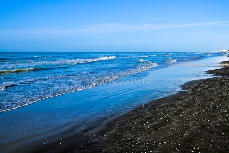 Black sand beach in Ladispoli, Italy. Beach with black volcanic sand in Ladispoli, Italy stock images