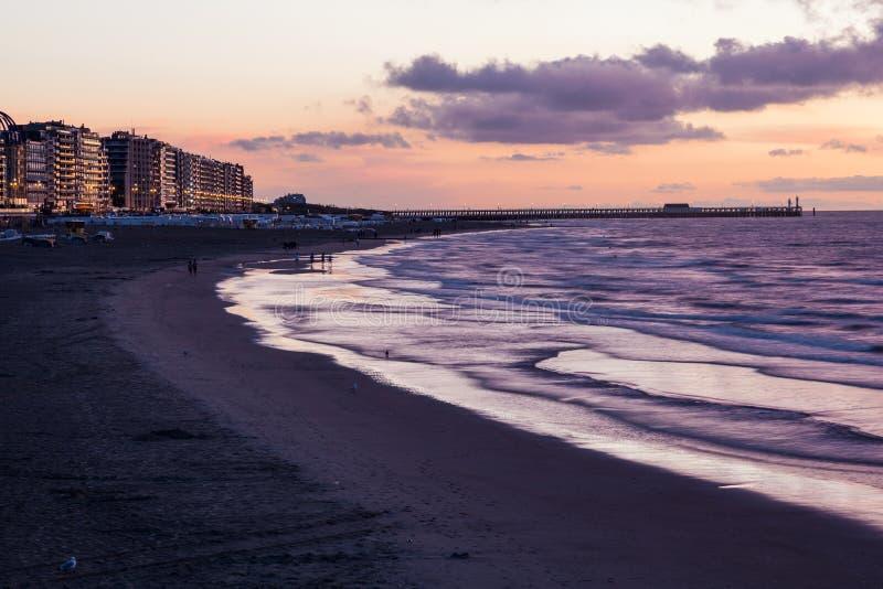Beach in Blankenberge at sunset, Belgium royalty free stock photos