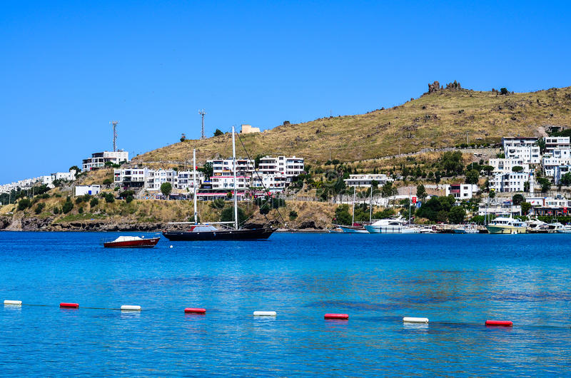 Beach in Bodrum,Turkey. Beach with calm sea and boats in Bodrum,Turkey stock images