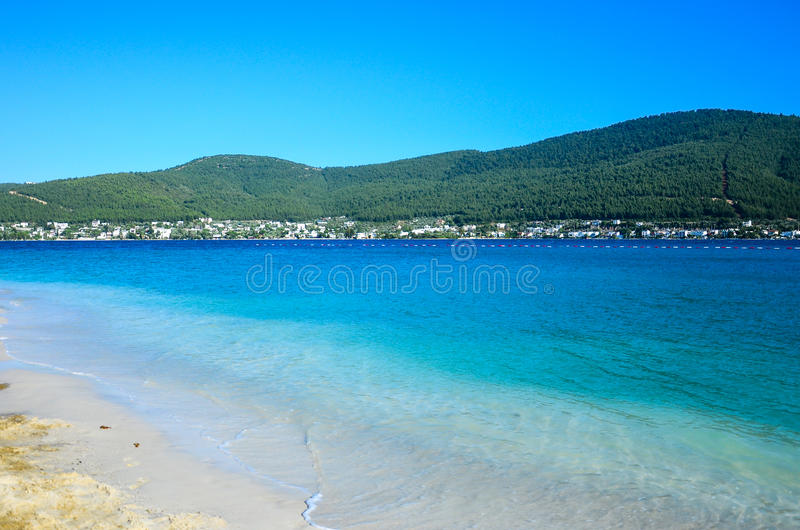 Beach in Bodrum,Turkey. Tropical beach at luxurious hotel with calm sea in Bodrum,Turkey royalty free stock image