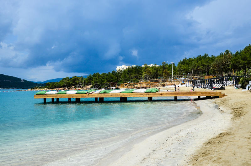 Beach in Bodrum,Turkey. Tropical beach at luxurious hotel with calm sea in Bodrum,Turkey stock image