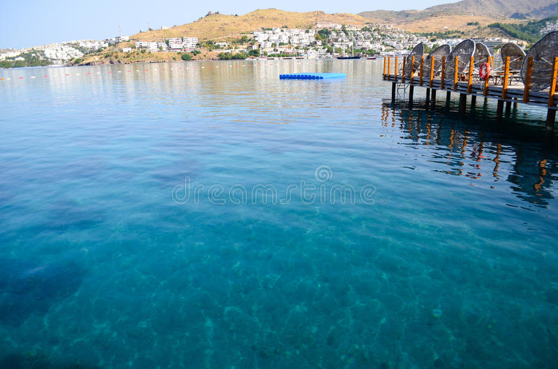 Beach in Bodrum,Turkey. Tropical beach at luxurious hotel with calm sea and palm trees in Bodrum,Turkey stock photos