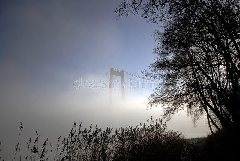 Beach, bridge and fog royalty free stock image