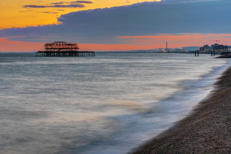 The beach in Brighton, England, after sunset stock photos