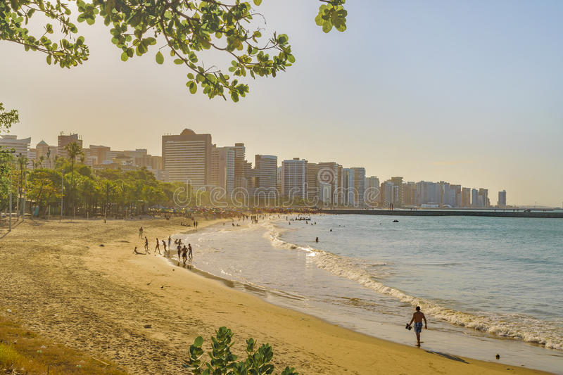 Beach and Buildings of Fortaleza Brazil. Cityscape scene depicting the coastline beach surrounded by modern modern buildings in Fortaleza, Brazil royalty free stock photography
